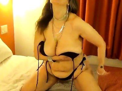 Tinja Drops Dark-skinned String Bikini Top To Show Perfect Breasts