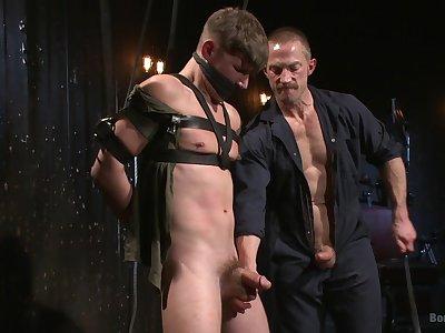 Gagged gay lad enjoys older male for a wild BDSM