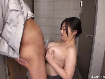 Busty Japanese wife drops on her knees to give an amazing titjob
